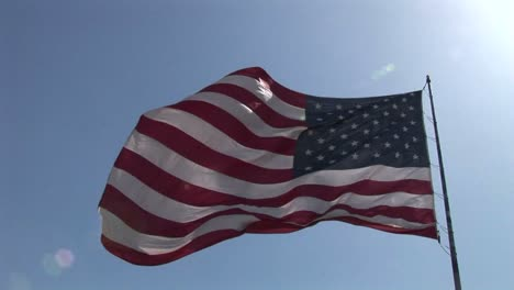 An-American-flag-flies-in-the-wind-at-day-1