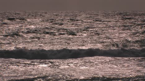 Choppy-waves-continuously-break-and-roll-onto-shore-1