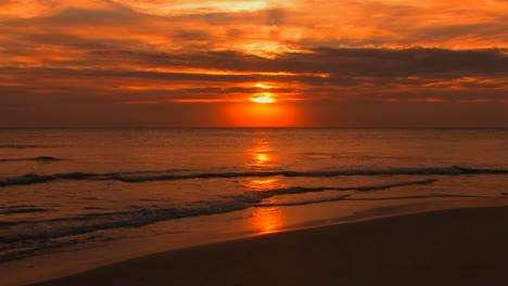 Beach-waves-slowly-break-during-sunset
