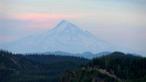 A-mountain-peak-rises-above-a-forest-at-Mt-St-Helens-National-Park-1