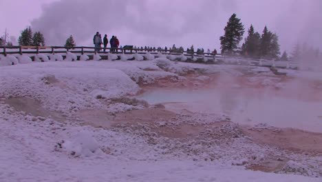 Tourist-gather-around-a-geothermal-area-in-Yellowstone-National-Park