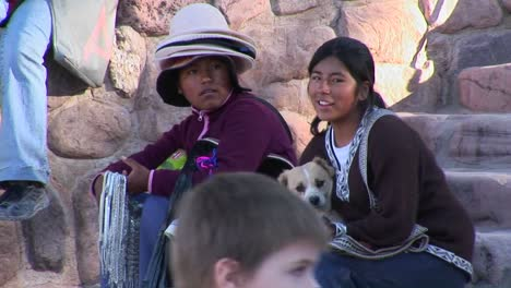 Latin-American-souvenir-sellers-hold-a-dog-at-a-tourist-attraction-in-South-America
