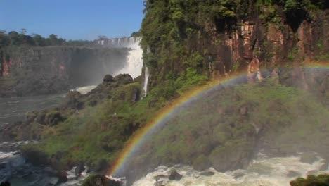 Pan-across-a-rainbow-at-Iguacu-Falls