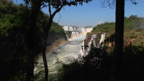 A-wide-shot-of-Iguacu-Falls-with-a-rainbow-in-the-foreground