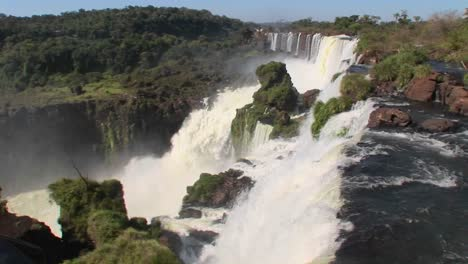A-perspective-looking-over-the-edge-of-a-waterfall-Iguacu-Falls