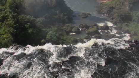 A-moving-perspective-looking-over-the-edge-of-a-waterfall-Iguacu-Falls-1