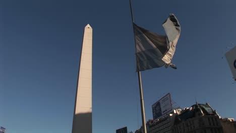 Buenos-Aires-Argentina-capitol-Nuevo-de-Julio-buildings-obelisk-and-Argentine-flag