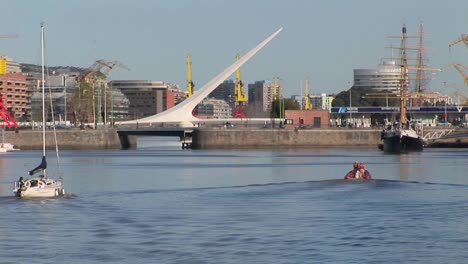 Buenos-Aires-harbor-with-sail-boat-and-bridge-Puerto-Madero