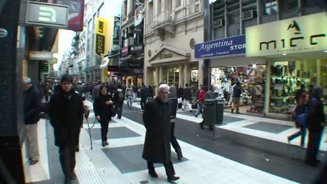 People-walk-through-a-city-shopping-area
