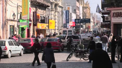 Traffic-is-jammed-on-a-busy-intersection-as-pedestrians-walk-around-and-a-bird-flies-by