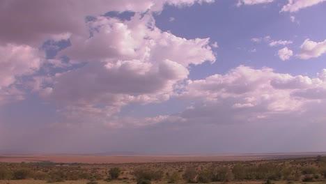 High-clouds-drift-over-grassy-plains