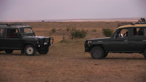 Two-off-road-vehicles-in-a-savanna