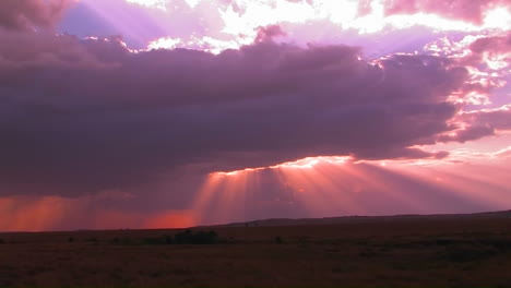 Beautiful-sun-beams-burst-forth-from-dark-clouds-onto-open-plains