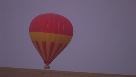 A-hot-air-balloon-rises-from-off-the-ground