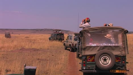 Four-off-road-vehicles-on-a-safari-in-the-desert