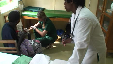 Sick-children-are-getting-a-checkup-by-two-doctors-at-a-clinic