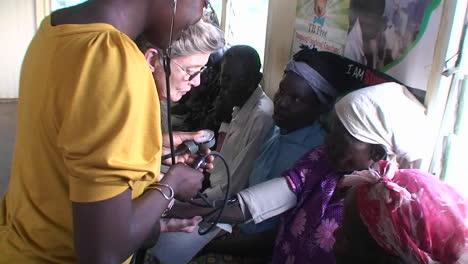 An-older-African-woman-gets-her-bloodpressure-read