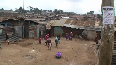 A-group-of-children-play-games-in-front-of-makeshift-homes-in-a-small-village