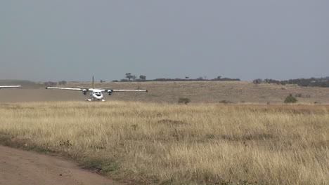 A-small-plane-takes-off-from-a-rural-dirt-road-airstrip