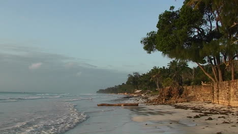 Calm-waves-come-ashore-a-beautiful-tropical-beach