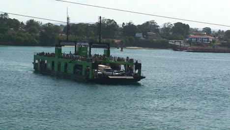 A-ferry-boat-carries-people-and-vehicles-across-a-body-of-water