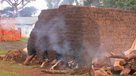 Smoke-billows-as-bricks-are-fired-at-a-construction-site-in-rural-Africa-