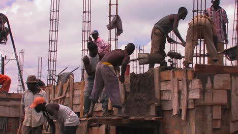 Workers-transport-building-materials-from-the-ground-to-the-roof