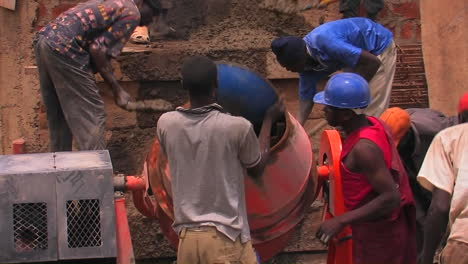 Construction-workers-mix-cement-for-a-building-project
