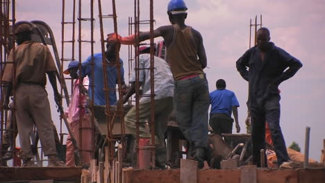 A-crew-of-men-work-on-constructing-a-building