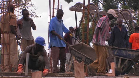 A-construction-crew-works-on-pouring-concrete-for-a-building