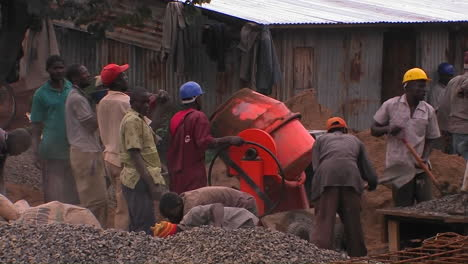 Men-on-a-work-site-shovel-and-mix-cement