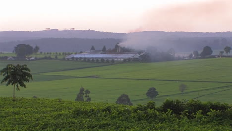 Smoke-billows-from-a-building-on-a-farm