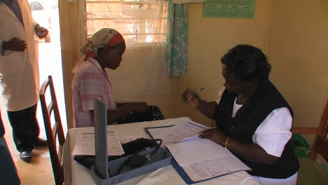 A-woman-receives-medication-and-consultation-from-medical-staff