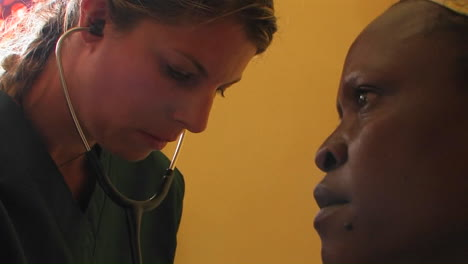 Doctor-checking-an-African-patient-s-breathing