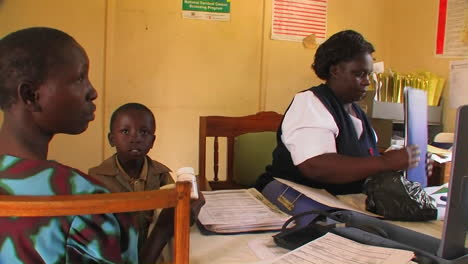 A-woman-gives-pills-to-children-in-Africa