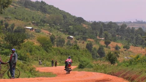 A-person-on-a-motorbike-pulls-to-the-side-of-a-rural-road