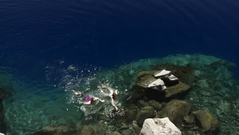 People-swim-in-the-clear-waters-of-Crater-Lake-Oregon