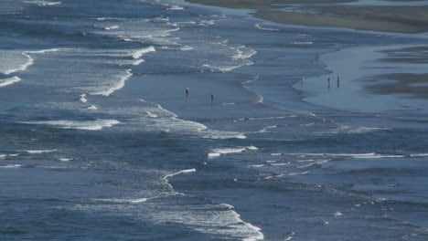 Ocean-waves-roll-into-a-beach-in-Oregon-or-Northern-California