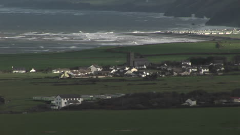 A-small-village-in-Ireland-with-the-coast-background