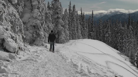 A-man-snowshoes-across-a-snowy-mountainside-1