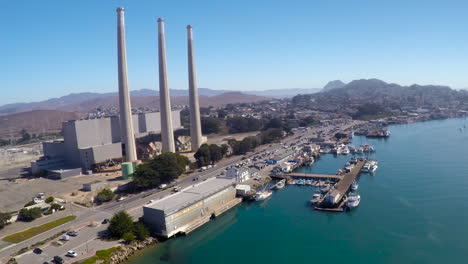 An-aerial-over-the-smokestacks-at-the-electrical-plant-in-Morro-Bay-California