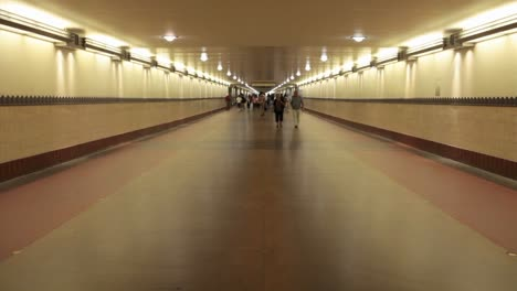 A-time-lapse-of-pedestrians-walking-through-a-long-hallway