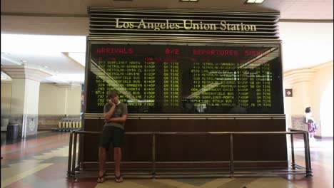 A-time-lapse-of-passengers-looking-at-train-arrivals-and-departures-at-the-Los-Angeles-Union-Station