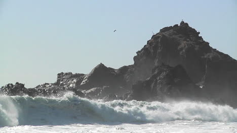 Waves-roll-into-shore-on-a-sunny-day-along-California-coastline-1