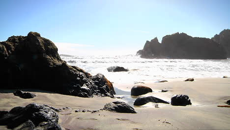 Waves-roll-into-shore-on-a-sunny-day-along-California-coastline-2