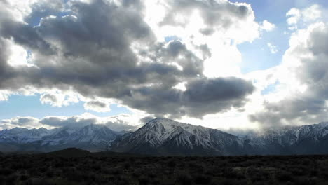 Time-lapse-shot-of-clouds-moving-over-Sierra-Nevada-mountains-in-winter