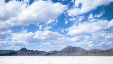 Time-lapse-of-clouds-moving-over-salt-flats-or-desert