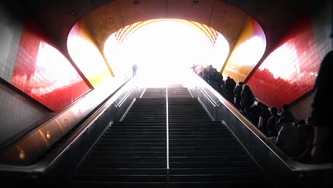 People-ascend-and-descend-via-stairway-and-escalators-at-a-metro-station-
