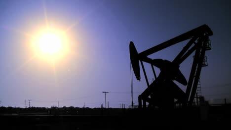 Silhouette-of-oil-pumpjacks-in-operation-