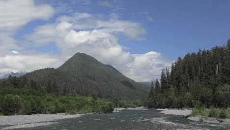 Time-lapse-of-clouds-passing-over-a-forest-mountains-and-river-